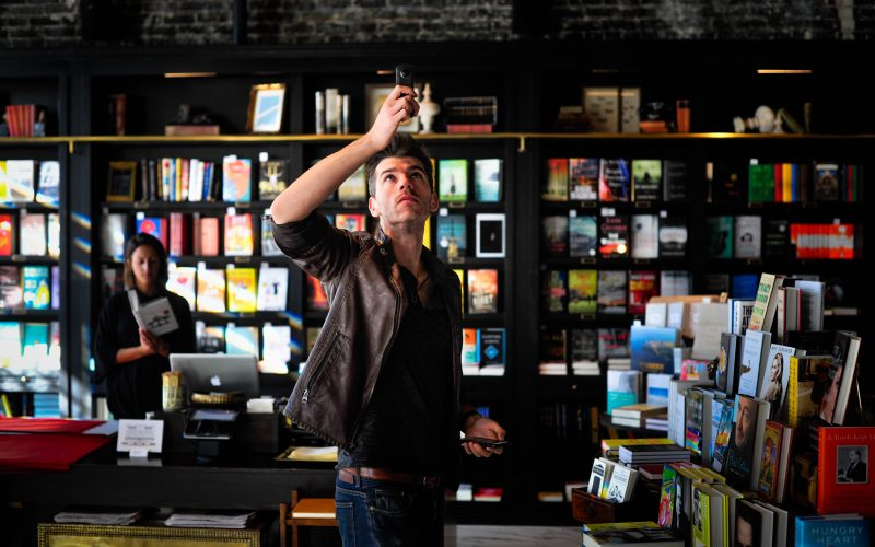 Man taking picture in bookstore